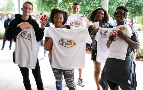 Trenton Niles, Nina Brooks, Marek Simmons, Alyssa Key, and Andres Montilla display school pride with the new t-shirts and chick-fil-A sandwiches they earned by making learning gains.