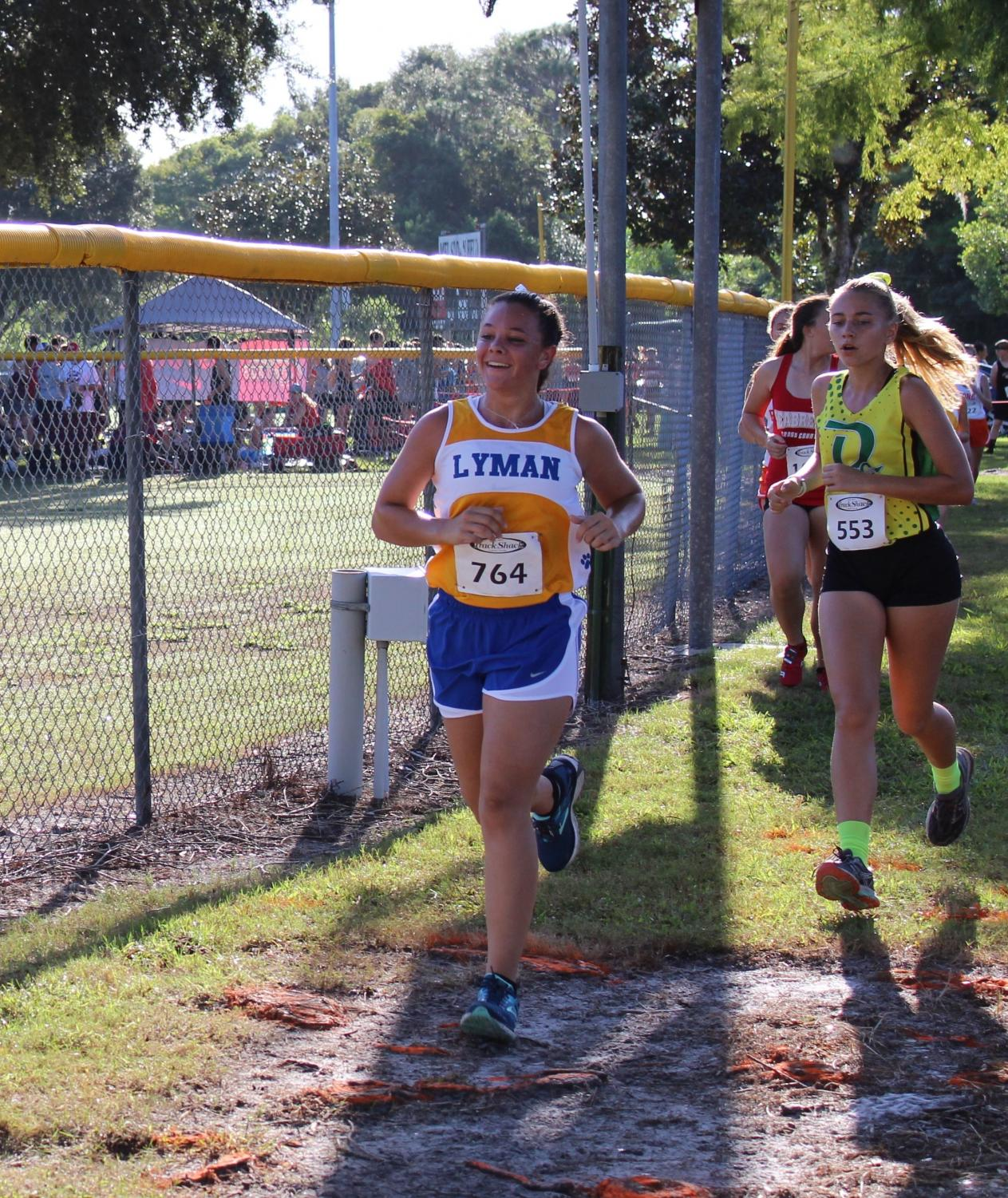 Emily Shilson ran with a time of 27:01 at her first race in Deland as a JV runner, and has since been promoted to the Varsity team.