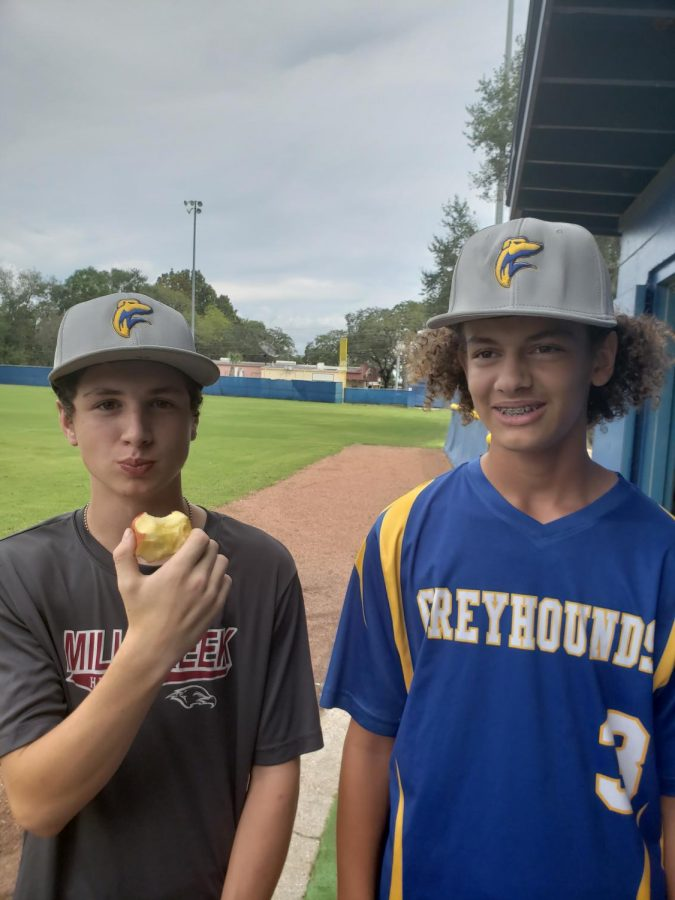 New Greyhounds, Riley Aagaard and Myles Green, beginning to start the chase at baseball practice.